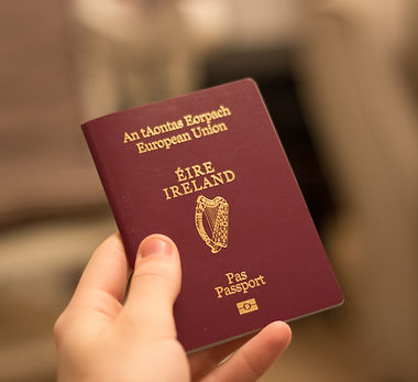 irish passport held in hand.jpg