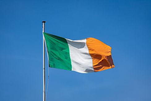 Irish flag on windy spring day in Dublin