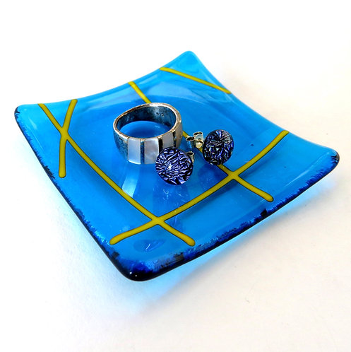 Bright blue lined fused glass ring dish
