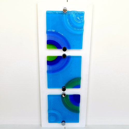 Blue and green ripple fused glass wall art