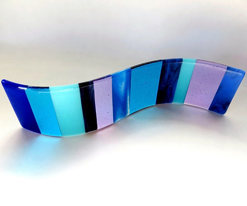 Blue and purple fused glass wave curve