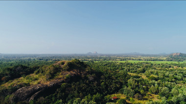Sigiriya Rock towers in the distance