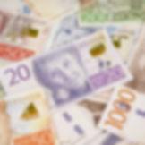 Hög med svenska sedlar