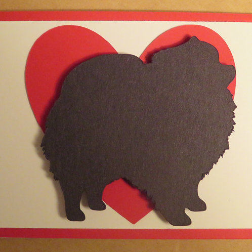 Pomeranian Silhouette in Front of Large Red Heart