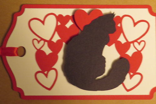 Long-Haired Cat Silhouette Sitting Under Canopy of Hearts