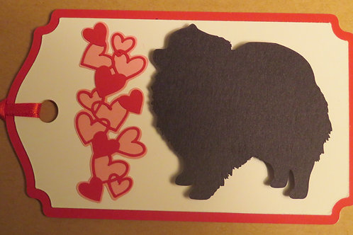 Pomeranian Silhouette Beside a Waterfall of Hearts