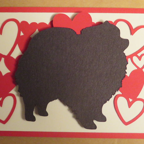 Pomeranian Silhouette Under Canopy of Hearts