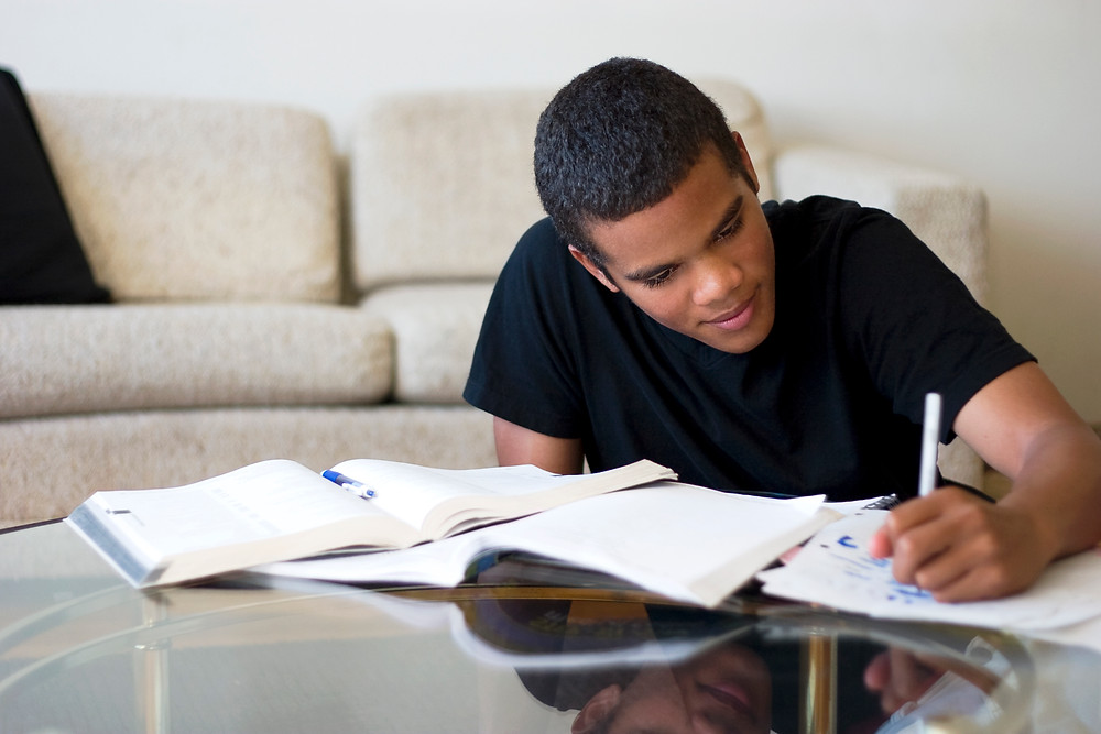 Busy Student Completing Homework Assignment