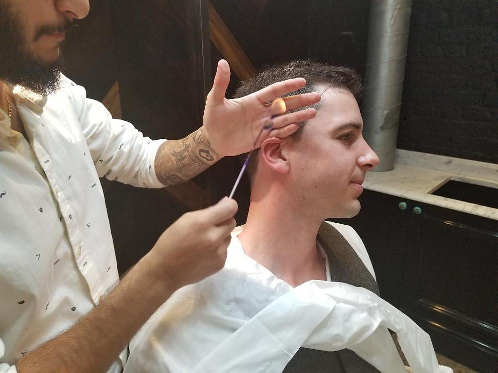 Dan having his ears flamed