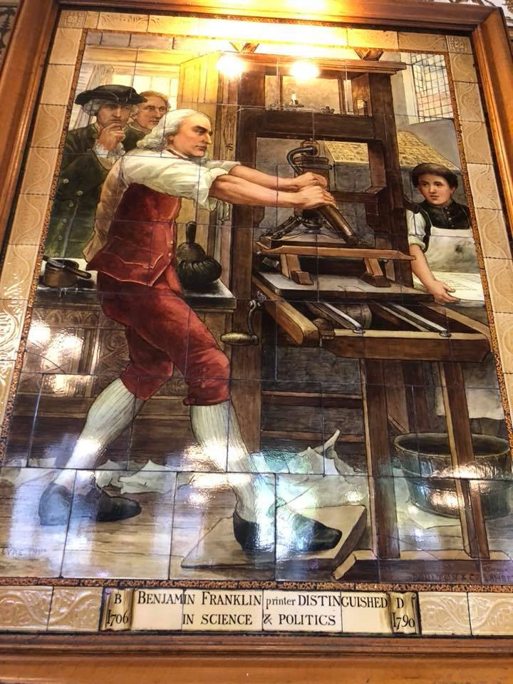 Ben Franklin and other inventor adorn the walls of the Cafe Royal
