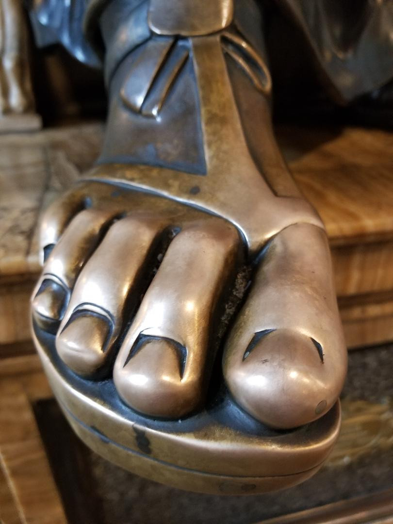 The foot of St. Peter in Westminster Cathedral, worn by the touches of the faithful.