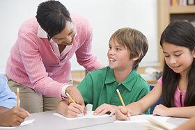 teacher helping boy with dyslexia