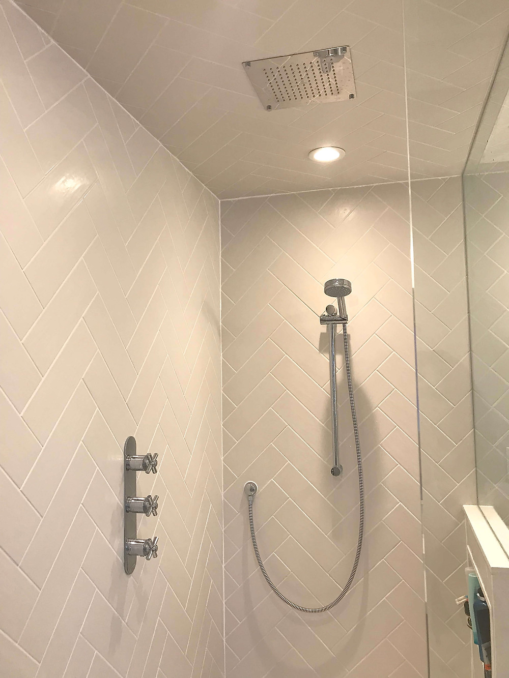 Rain shower and fixtures by Georgia's Design