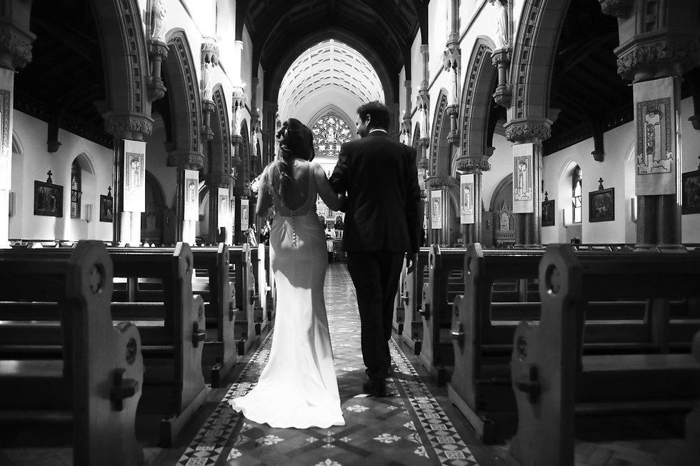 Wedding photography bride walking up the