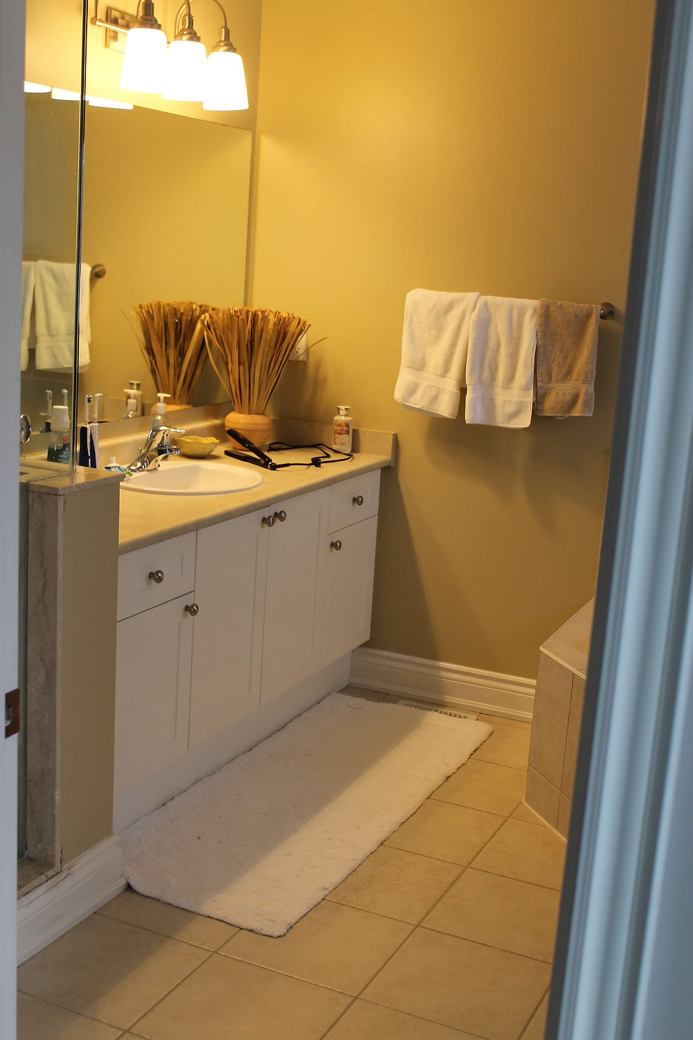 Dark and dated bathroom before by Georgia's Design