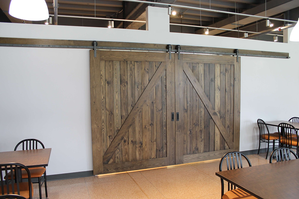 Custom barn doors at Providence Healthcare by Georgia's Design