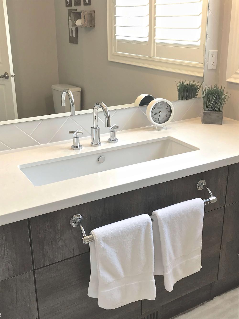 Trough sink in rustic style bathroom by Georgia's Design