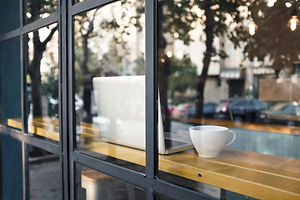 The American Society of Professional Copywriters: The CopyPros leave a tablet in the window with a cup of coffee while reviewing the copywriter's work.