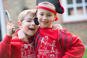Two boys playing pirates