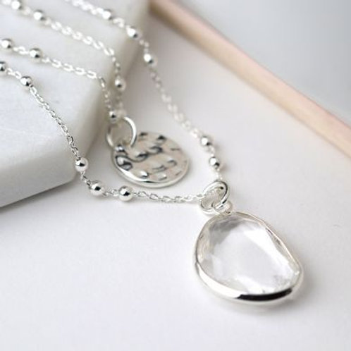 Silver disc and clear crystal layered necklace