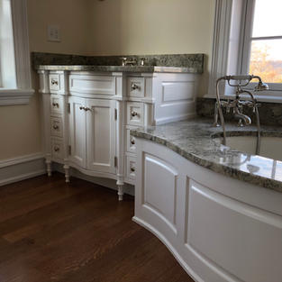 bathroom vanity and tub surround.JPG