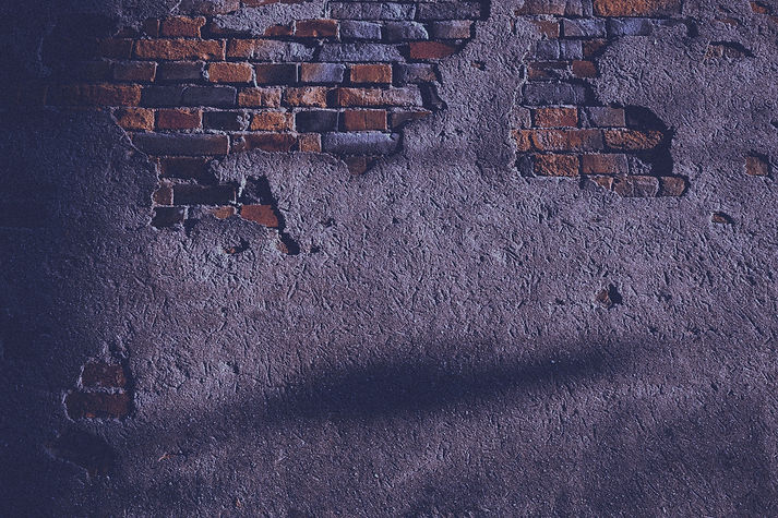 wall with broken bricks_edited_edited.jpg