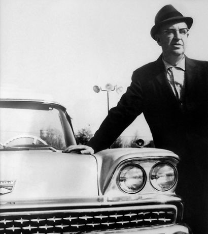 George E. Lancaster stands with a '59 Ford Fairlane.