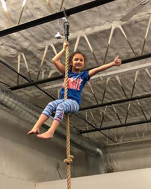 Little girl on rope