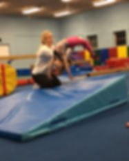 Litle girl doing back handspring