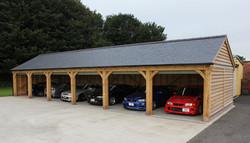 Oak_Frame_Six_Bay_Garage_with_Roller_Shutter_Doors_Lancashire