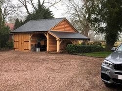 Oak_Frame_Two_Bay_Garage_and_Log_Store_Chester