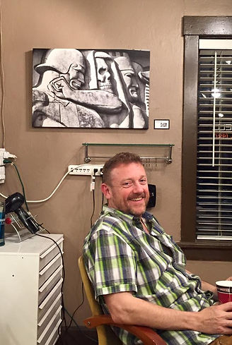 Bryan relaxing after setting up for his first public showing at B-Vogue Salon and Art Gallery