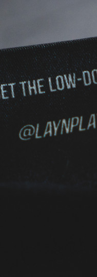 Lay N Play tee label