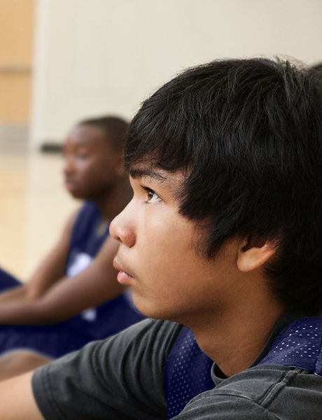 Basketball Players Listening to Coach
