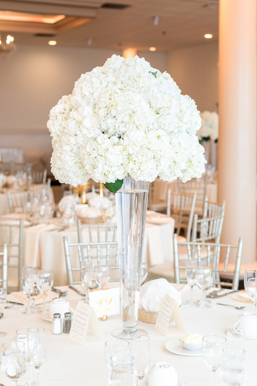 White floral centerpiece by Mayuri's Floral Design