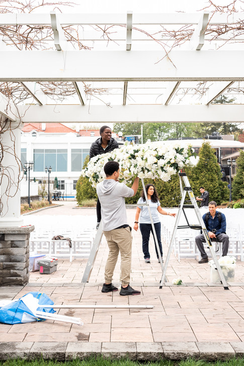 Mayuri's Floral Design and her team setting up for an outdoor ceremony