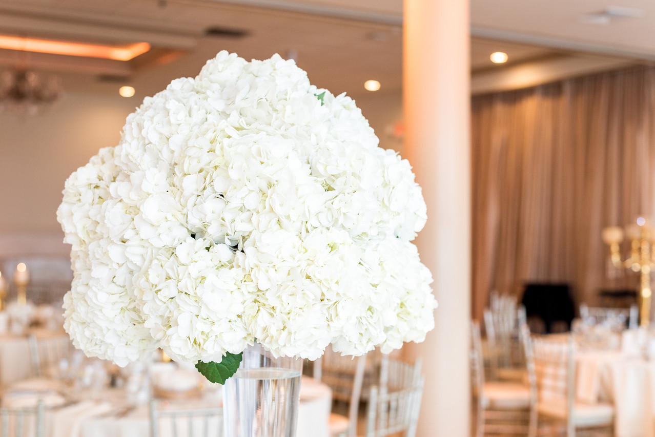 Closeup of a floral centerpiece by Mayuri's Floral Design at the Greentree Country Club