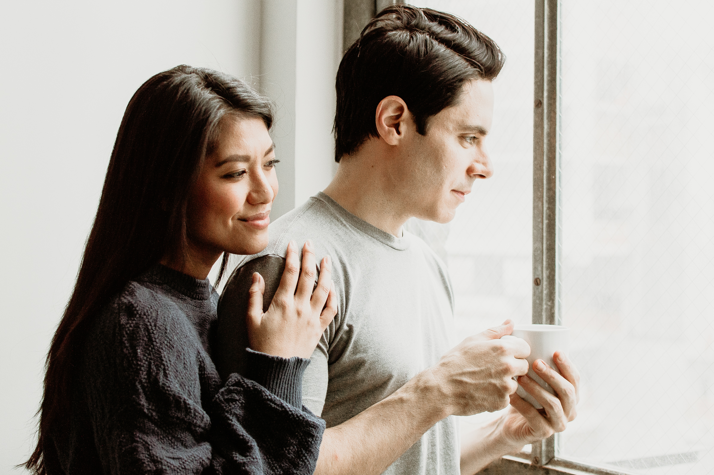 Couple enjoying coffee and looking out the window