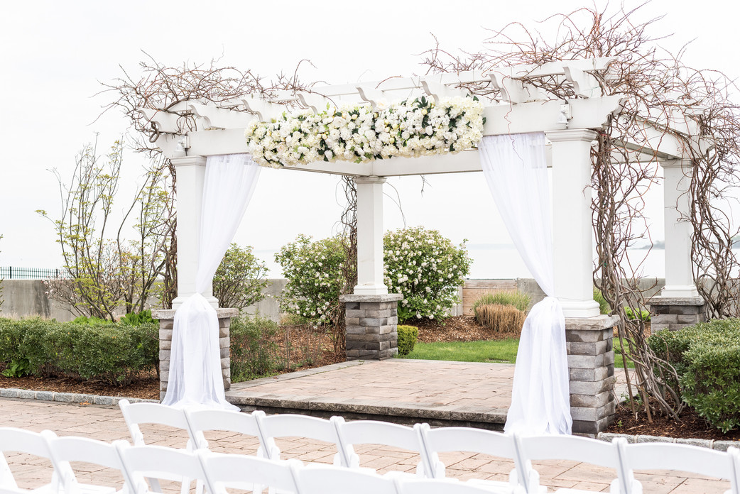 White florals and drapery for an outdoor ceremony by Mayuri's Floral Design