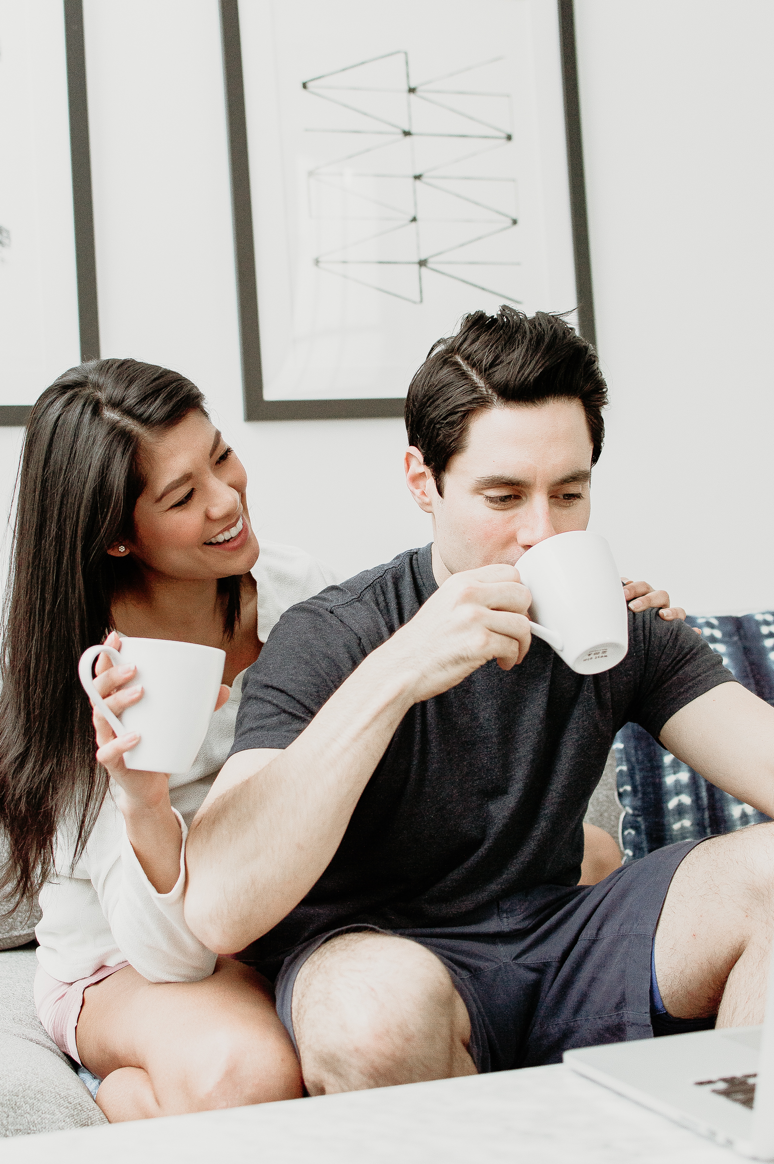 Couple enjoying coffee together on the couch