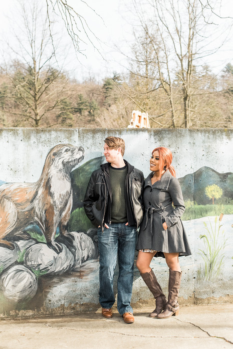 Couple posing by otter mural at the Lehigh Valley Zoo