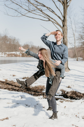 Couple with fun and spontaneous poses in the snow