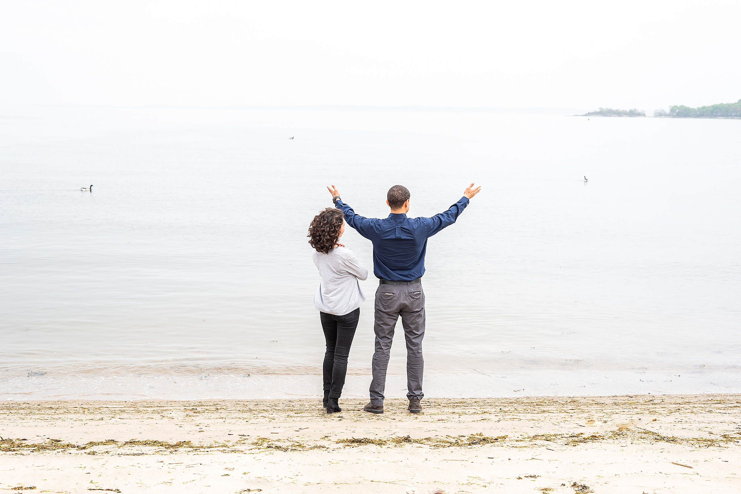 Couple admiring the beach at the Green Tree Country Club