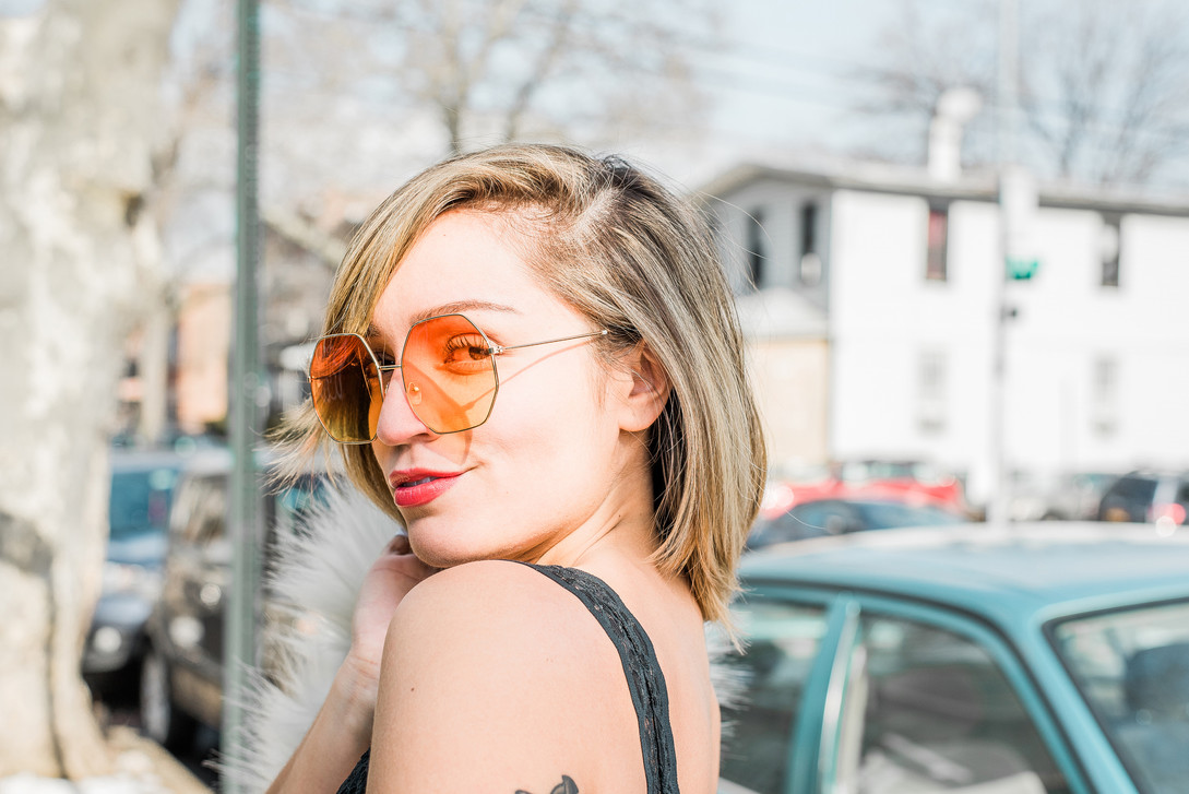 Portrait photo of a girl with orange sunglasses in Queens