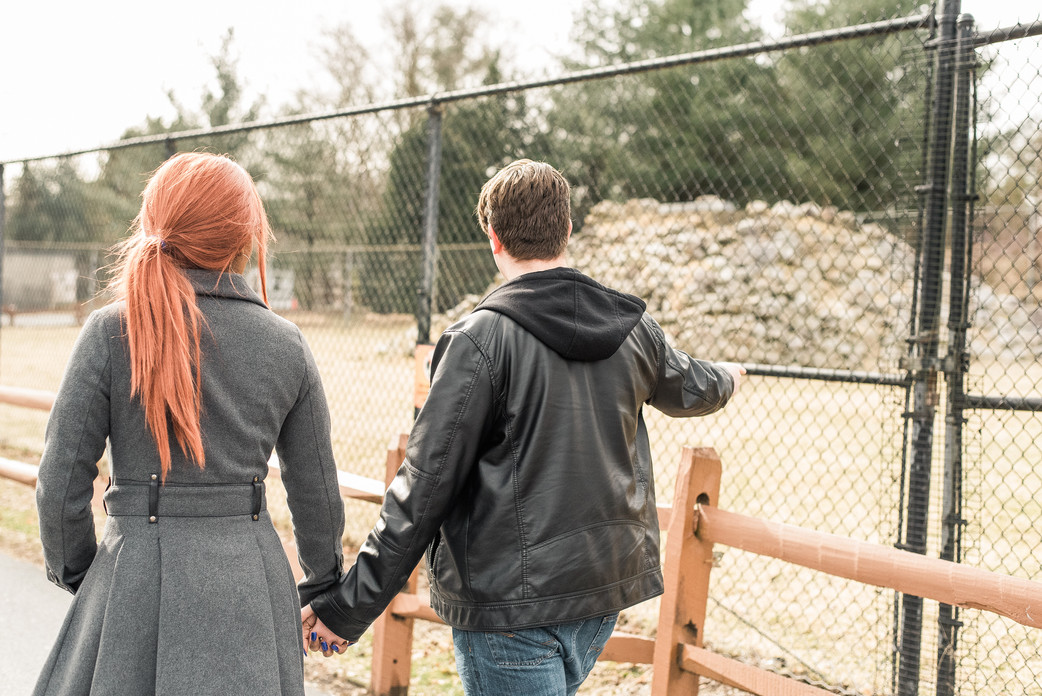 Boyfriend and girlfriend holding hands at the zoo