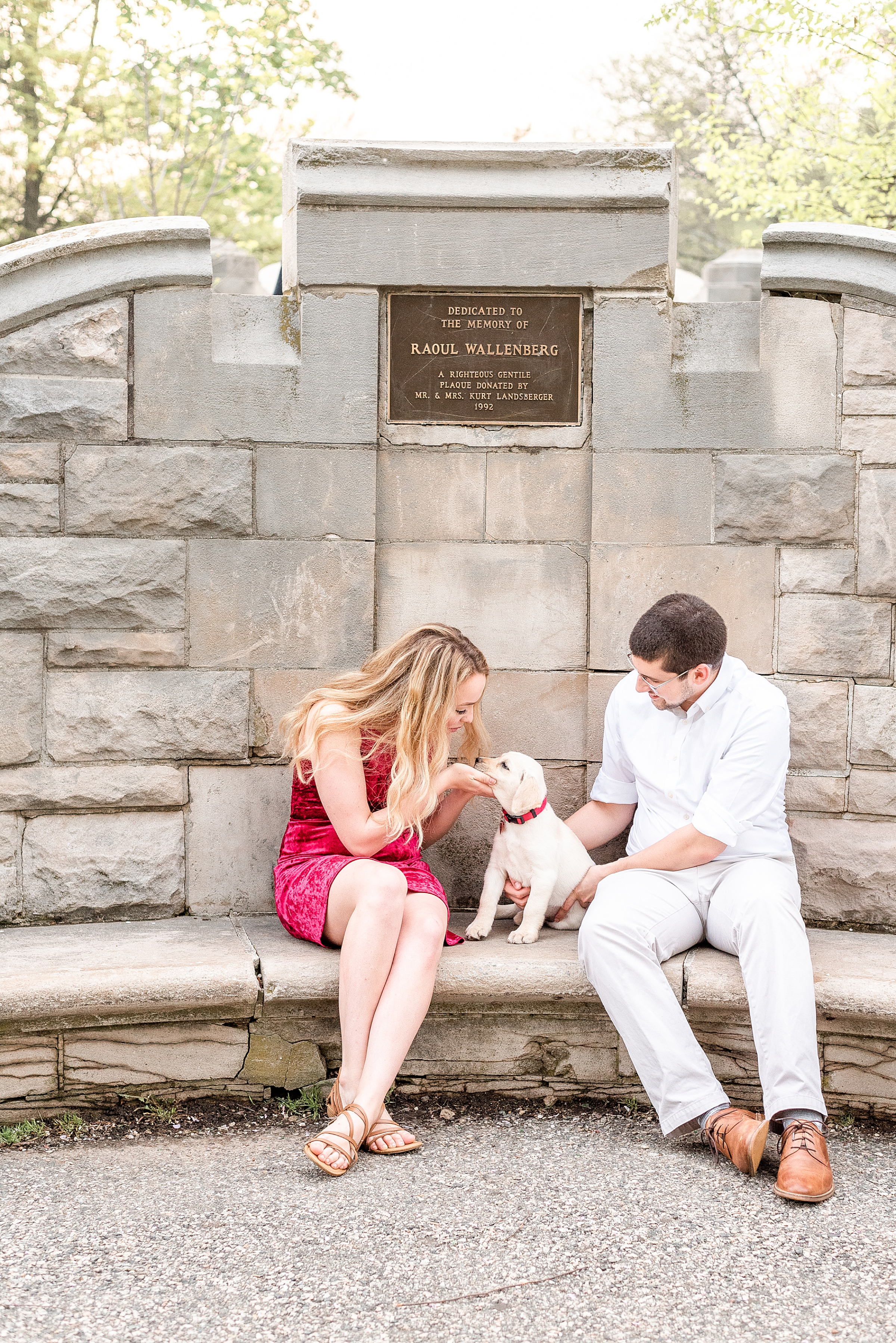 Couple playing with their puppy in Verona Park, NJ