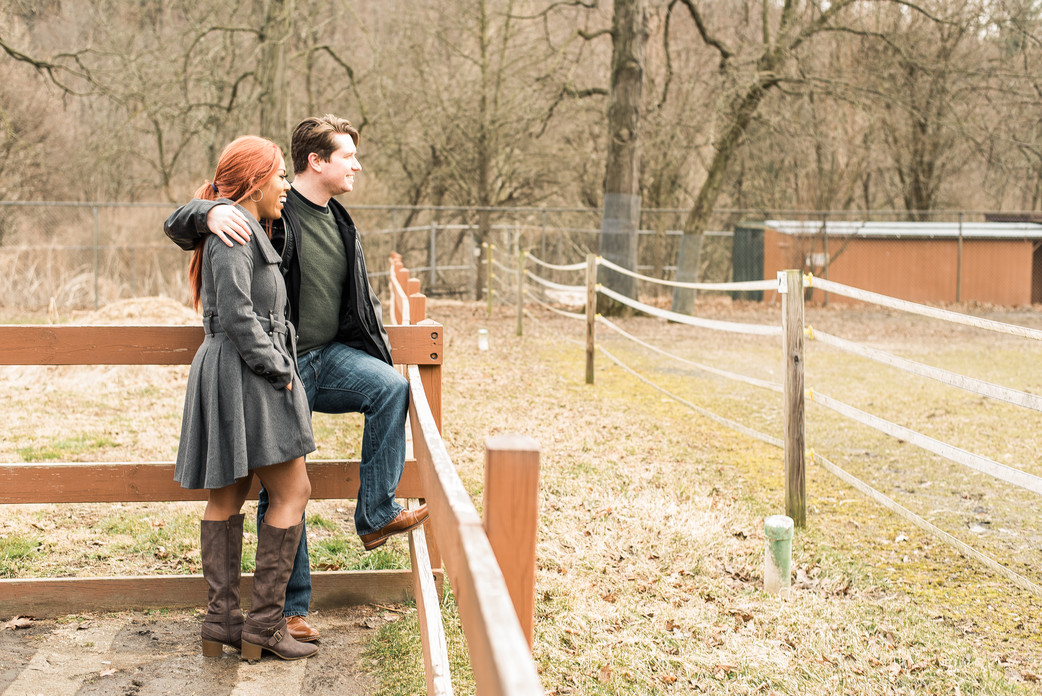 Couple posing by a fence in Pennsylvania