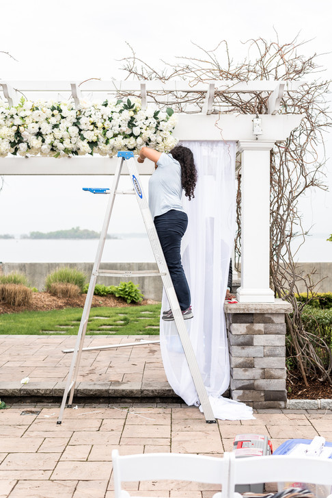 Mayuri and her team setting up for an outdoor ceremony at the Greentree Country Club