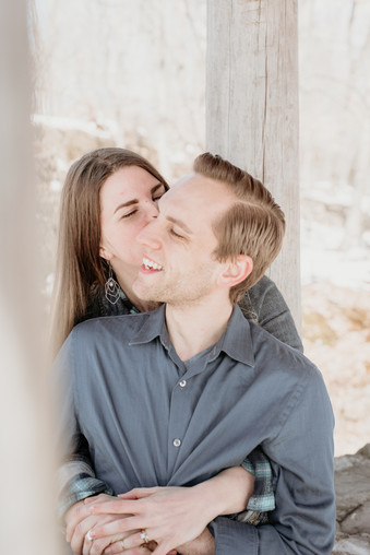 Wife kissing her husband during a winter session