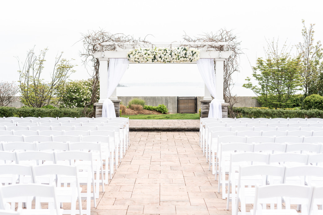 White florals and drapery for an outdoor ceremony at the Green Tree Country Club